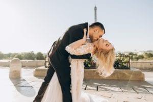 Photo of groom embracing bride